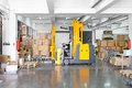 Forklift stacker electric moving boxes in warehouse Stock Photo