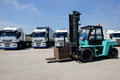 Forklift truck and containers in an establishment of industrial transport in rome Stock Photography