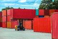 Forklift truck lifting cargo container