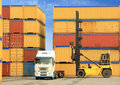 Forklift and truck with shipping containers Royalty Free Stock Photo