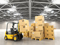 Forklift truck in warehouse or storage loading cardboard boxes. Royalty Free Stock Photo