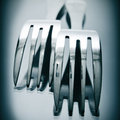 Forks closeup of some on a reflecting surface Royalty Free Stock Image