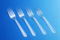 Forks four with blue background Royalty Free Stock Photo