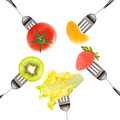 Forks with fruits and vegetables isolated on white background Stock Photography