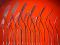 Forks group of standing against an orange background Royalty Free Stock Photography