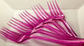 Forks on plate five pink plastic a white Royalty Free Stock Photo