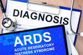Form with diagnosis and tablet with acute respiratory distress syndrome ards word Stock Images