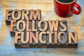 Form follows function design concept text in vintage letterpress wood type printing blocks with a cup of coffee Stock Image