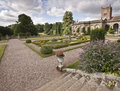 Formal box gardens the and st andrew s church at weston park a stately home on the shropshire staffordshire border in england Stock Photo