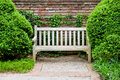 Formal garden at spring bench in green Royalty Free Stock Photo