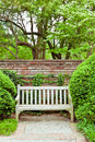 Formal garden at spring bench in green Stock Photos