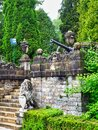 Formal Gardens and Antique Canon, Peles Castle Grounds, Romania Royalty Free Stock Photo