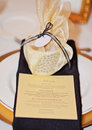 Formal table setting a candlelit gold and black evening wedding reception Stock Photography