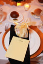Formal table setting a candlelit gold and black evening wedding reception with blank menu Stock Photos