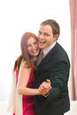 Formally dressed happy couple having fun dancing Stock Photos
