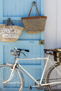 Formentera old bicycle leaning against blue door Royalty Free Stock Image