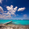 Formentera tropical mediterranean sea wooden pier in illetes beach balearic islands Stock Photos