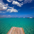 Formentera tropical mediterranean sea wooden pier in illetes beach balearic islands Stock Image