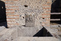 Former drinkable fountain in pompeii the ruin city Stock Photo