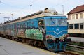 Former yugoslav railways electric locomotive with graffiti belgrade station serbia march a blue liveried railway engine of the Royalty Free Stock Photo
