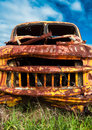 Formerly scary abandoned s yellow truck rusting in a field variations of this subject available Stock Image