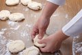 Forming rolls of dough baker's hands Stock Photography