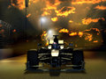 Formula one race close up on a single racing car at the foreground of a sunrise sky Royalty Free Stock Photos
