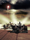 Formula one race close up on two racing cars at the foreground of a dark sky vertical image Stock Image