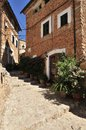 Fornalutx historical street with stone stairs in village in mallorca spain Stock Photo
