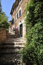 Fornalutx narrow stone street with stairs in village in mallorca spain Royalty Free Stock Photo