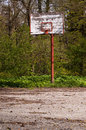 Forsaken basketball court abandoned in the middle of nature Royalty Free Stock Photo