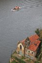 Forsaken church with graffiti on the bank of duoro river and tourist boat in porto Royalty Free Stock Photo