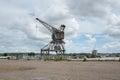 Forsaken crane on port Royalty Free Stock Photo