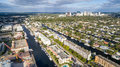 Aerial skyline view of Fort Lauderdale's Intracoastal waterway canals and residential homes.