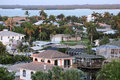 Fort Myers Beach back bay homes glowing as the sun sets Royalty Free Stock Photo