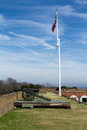 Fort pulaski cannon and flag at next to tybee island Royalty Free Stock Photo