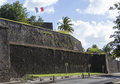Fort saint louis in fort de france martinique french flag on a top of Royalty Free Stock Photo