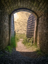 Fort tunnel with iron gate Royalty Free Stock Photo