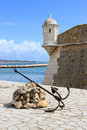 Fort on the waterfront in lagos century fortress with an anchor seafront of algarve portugal called forte ponta da bandeira Royalty Free Stock Photography