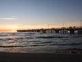 Forte dei Marmi`s pier Pleople walking while sun is setting