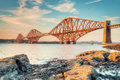 Forth rail bridge at sunset a shot of the victorian era crossing the estuary in eastern scotland taken from the shoreline Stock Images