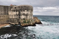 Fortress of dubrovnik tower croatia with heavy clouds and sea Royalty Free Stock Photography