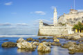 The fortress of el morro in the bay of havana long exposure image with rocks and silky water Stock Photo