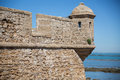 Fortress merlon detailed view of at the edge of the ocean spain Royalty Free Stock Images