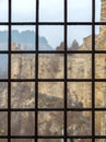Fortress seen through the prison window with metal bars brick Stock Photo