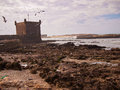 The fortress stands on the beach at low tide Royalty Free Stock Images