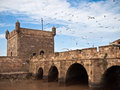 Fortress tower with a bridge on the sky background Royalty Free Stock Image