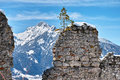 Ruined wall of medieval castle in alpine winter landscape Royalty Free Stock Photo