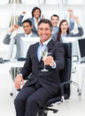 Fortunate manager and his team drinking champagne Royalty Free Stock Photo