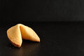 Fortune cookie  on a black background Royalty Free Stock Photo